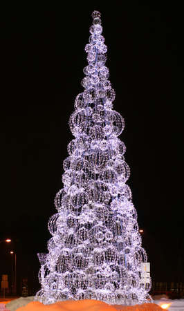 Beautiful Christmas tree is shining and sparkling in the night with wonderful colors in Riga, Latvia photo