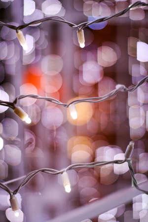 Closeup of christmas lights on a tree and beautiful bokeh Stock Photo