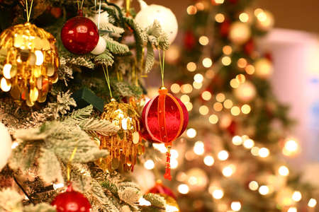Christmas tree closeup with beautiful and colorful ornaments