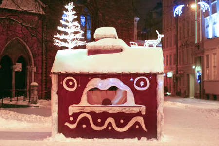 Christmas big gingerbread cookie house with ornates at Dome square in Old Riga, Latvia