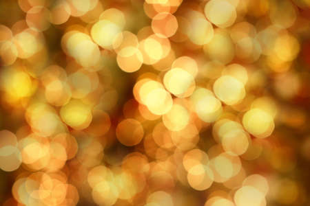 Golden Christmas lights at night. Beautiful blurred background. photo