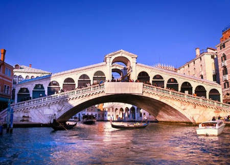 Colorful Rialto Bridge at Grand Canal, Venice, Italy. Editorial