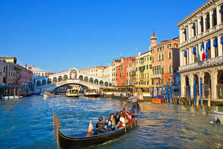 Beautiful view from Grand Canal on Rialto Bridge and heavy water traffic in Venice, Italy