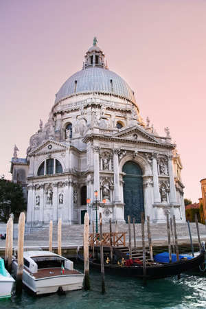 Colorful Basilica di Santa Maria della Salute with gondolas in Venice, Italy photo