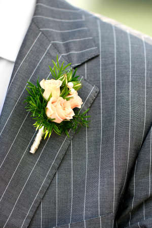 Wonderful wedding boutonniere on a costume of groom from beautiful colorful flowers. Stock Photo - 13100856