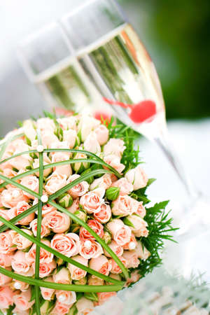 Wonderful wedding luxury bouquet of roses and glasses of champagne. photo