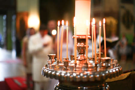 Wedding accessories and inter in Saint Trinity Orthodox Convent including candlesticks with many candles and people in a background. Wonderful church in Riga, Latvia Stock Photo - 13100857