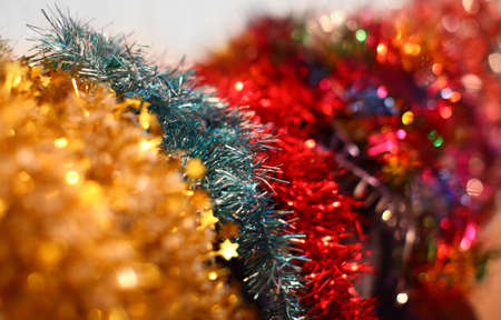 Multi colored Christmas garlands with beautiful blurred background. photo