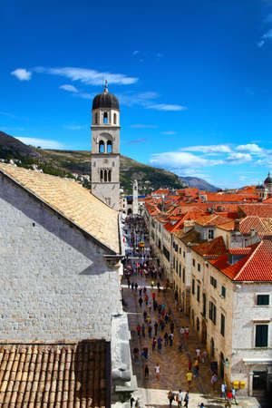 View of the main Stradun street of Dubrovnik and classic red tiled rooftops of city