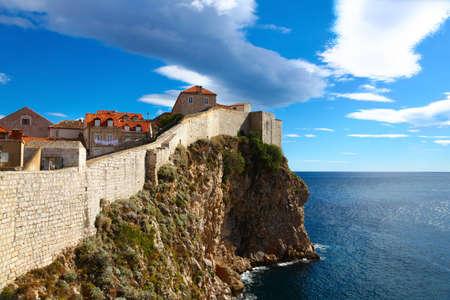 croatia dubrovnik: Defense wall of Old town of Dubrovnik in Croatia with beautiful view of Adriatic sea Stock Photo