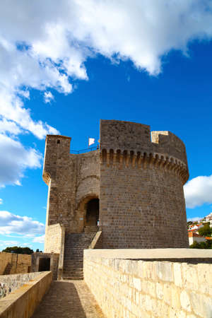 Minceta Tower of defense wall of Old town in Dubrovnik, Croatia with cloudy blue sky Stock Photo - 17837921
