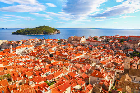 View of many landmarks of Old town in city of Dubrovnik, Croatia. Classic red tiled rooftops with Adriatic sea and island also are beautiful. photo