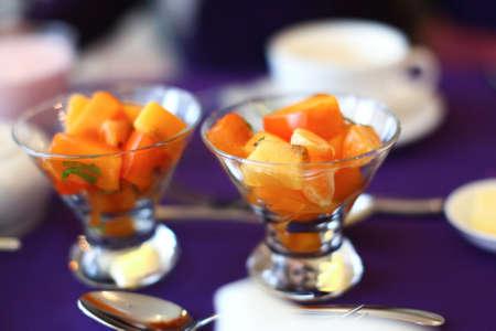 Tasty fruit dessert from mix of apple, orange, mandarin orange, persimmon, pineapple and peach