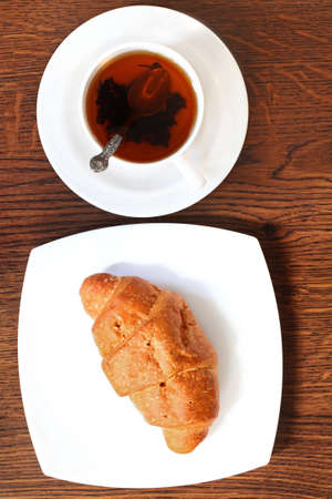 Croissant with hot cup of tea  Healthy morning breakfast