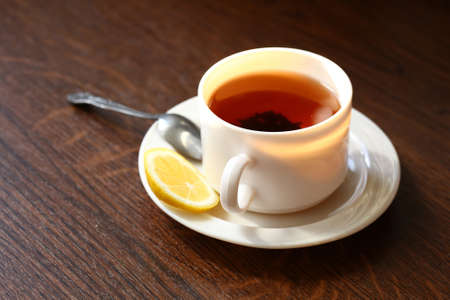 Hot cup of tea and lemon  Healthy morning breakfast Standard-Bild