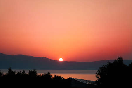 Sunrise over Mediterranean sea on island of Crete, Greece