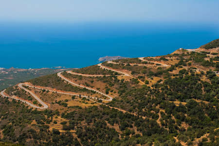 Mountain serpentine with many dangerous turns  Road near to Mediterranean sea at island of Crete, Greece