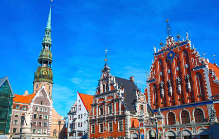Heart of Old Town in Riga, Latvia with many landmarks  House of the Blackheads is to the right, Saint Peter