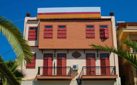 Traditional house with palms in city of Chania on island of Crete, Greece