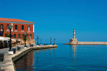 Beautiful promenade and famous lighthouse in city of Chania on island of Crete, Greece Stock Photo