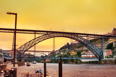 Fantastic panoramic sunset over Dom Luis Bridge and Douro river in center of Porto in Portugal Stock Photo