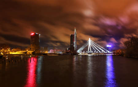 Panorama of Riga, Latvia at night  Skyscrapers and Cable-stayed bridge over the river of Daugava with beautiful dark clouds