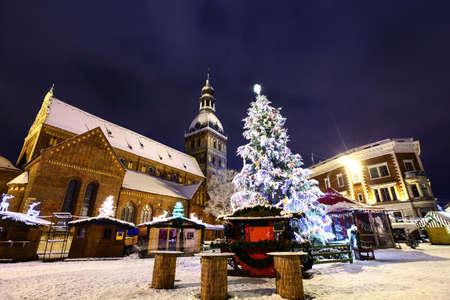 Christmas market at Dome square in Old Riga, Latvia at winter night Stock Photo