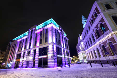 Modern architecture and Town hall in Old Riga, Latvia at winter night Standard-Bild