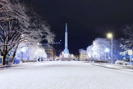 Monument of Freedom in center of Riga, Latvia at winter night Editorial