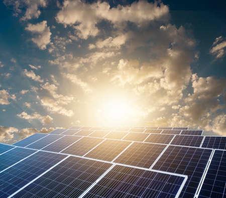 Sunset over Solar energy Farm plant.