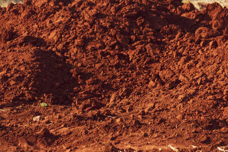 Red ground soil texture in brazil. Imagens