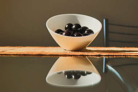 Fruit - Concept image of jabuticaba in the pot at the dinner table, selective focus