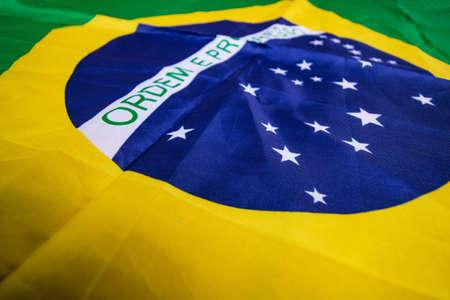 Brazilian flag kneaded - Dramatic concept image image.