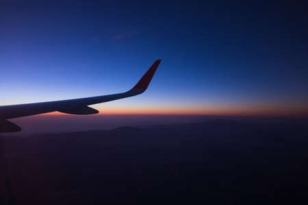 Sunrise on window plane wiew, with mountains on the background in the region of Cancun
