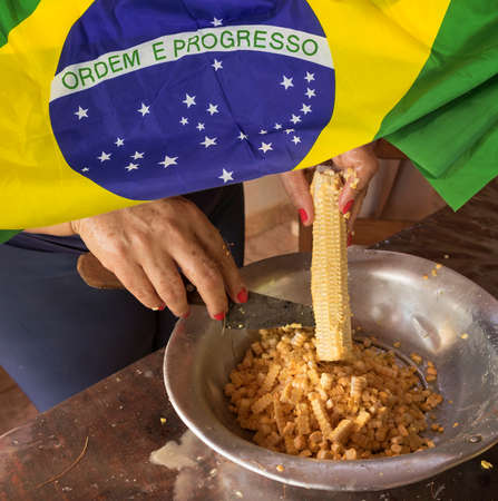 Typical food of junina party with flag of brazil. Concept image of famous Brazilian cultural party.