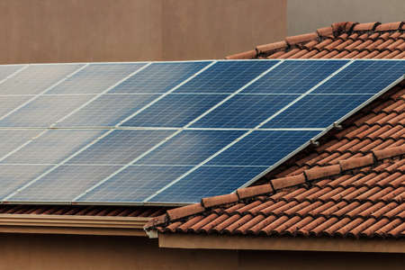 Solar photovotaic panel at a roof at suset. Solar energy house company concept image.