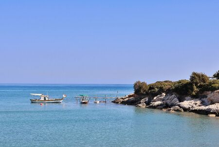 A calm Mediterranean scene with fishing boats