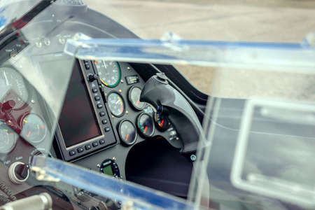 outside shooting: Autogyro cockpit with instrumental panel and control stick outside shooting