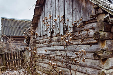 barns winter: Old abandoned wooden house with boarded up windows