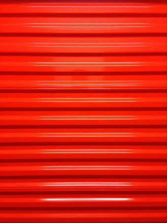 self storage: A red door in a self storage facility.