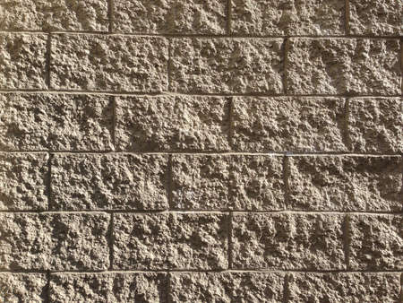Textured concrete blocks reveal their texture in sunlight.