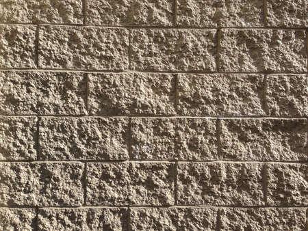 Textured concrete blocks reveal their texture in sunlight.