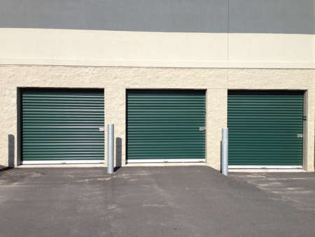 self storage: Green self storage doors that open outside for drive up access.