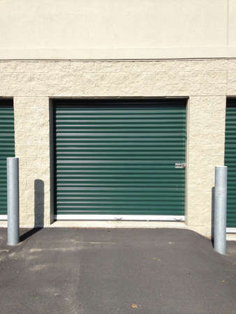 Green self storage doors that open outside for drive up access.