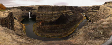 The Palouse River goes over a waterfall and around a bend at Palouse Falls in Eastern Washington state.