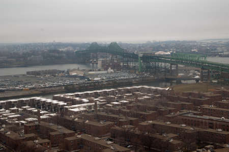 An overhead view of the Tobin Bridge and homes in the Charlestown neighborhood of Boston.