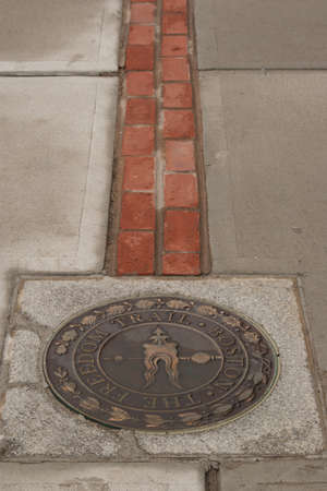 The Freedom Trail in Boston is marked by a metal medallion next to the Bunker Hill Monument in Charlestown.