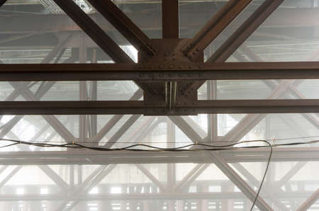 The bridge supports of the Fore River Bridge in Weymouth Ma on a foggy day.