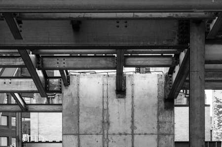 girders: A concrete elevator shaft and steel girders in a new building construction. Stock Photo