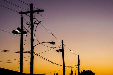Utility poles against a sunet sky. Reklamní fotografie